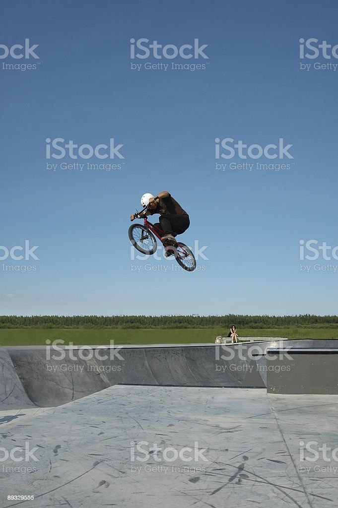 Biker performs aerial BMX trick. Lots of copyspace. royalty-free stock photo