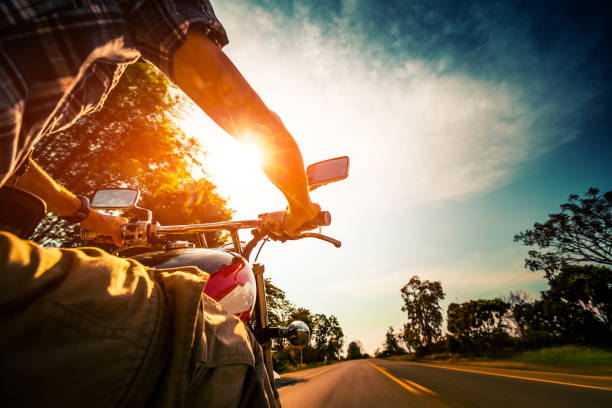 Biker rides motorcycle stock photo