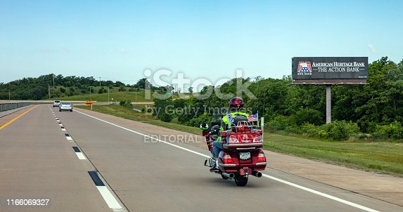 USA Highway in Texas, May 13th, 2019. Rear view of a biker riding a moto to Amarillo