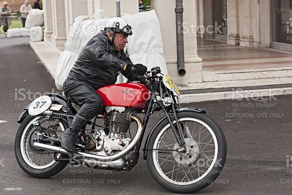 biker riding a vintage motorcycle Gileta royalty-free stock photo