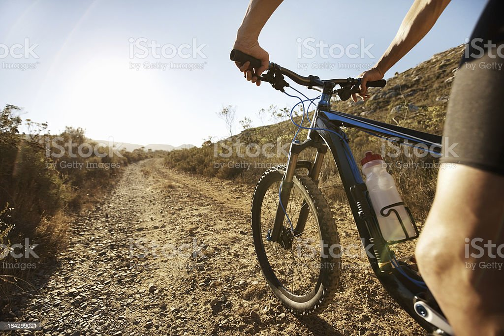 Biker riding bicycle on a sunny day royalty-free stock photo
