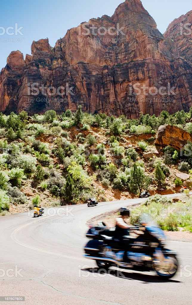 Biker riding through Zion National Park royalty-free stock photo
