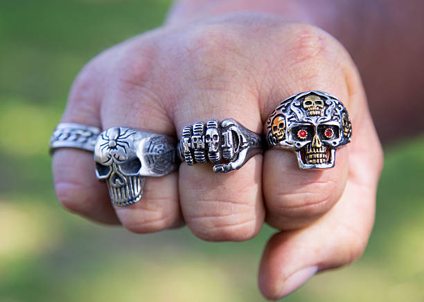 biker rings - gold tooth stock photos and pictures