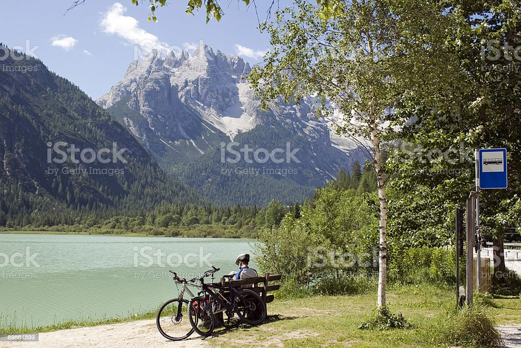 Biker sitting in front of beatiful Dolomites view royalty-free stock photo
