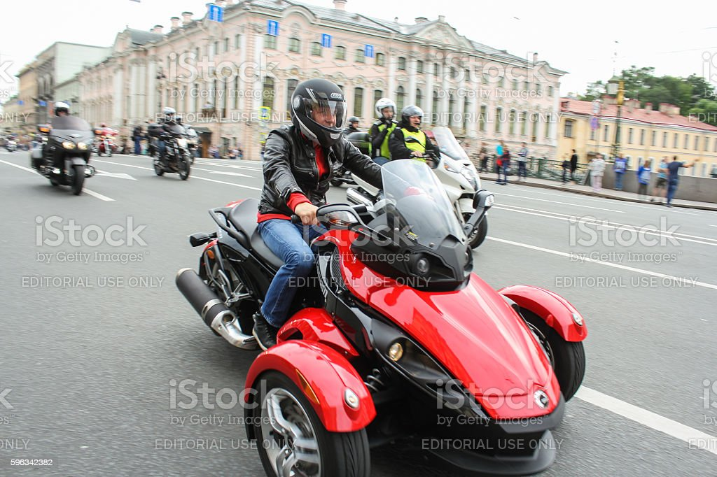Biker tricycle on a green bridge over the Moika River. royalty-free stock photo