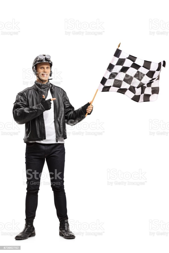 Biker waving a checkered race flag and pointing stock photo