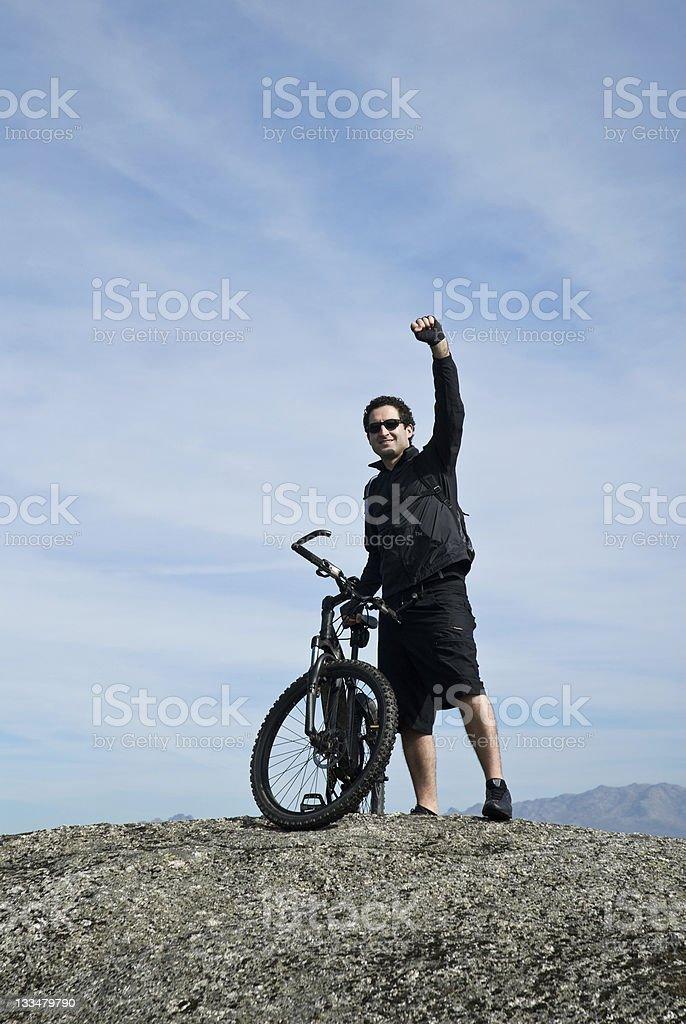 biker waving victory royalty-free stock photo