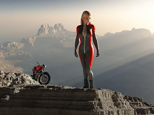 biker woman on mountain peak - motorbike racing stock photos and pictures