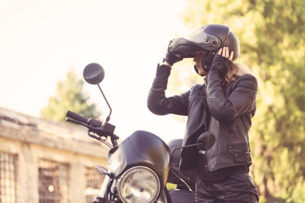 biker woman - biker stock photos and pictures