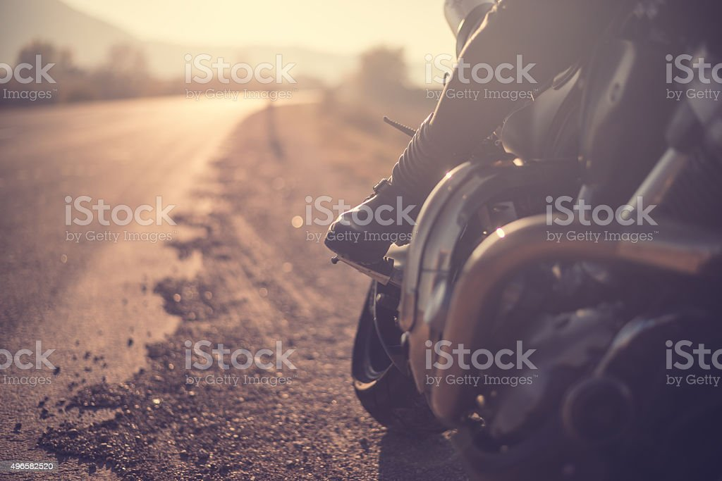 Biker woman riding on a motorcycle stock photo
