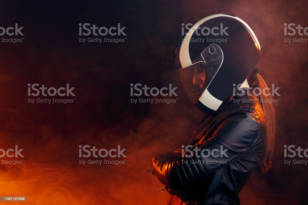 Biker Woman with Helmet and Leather Outfit Portrait stock photo