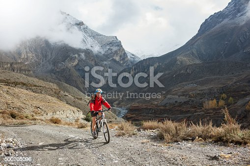 istock Biker-girl in Himalaya mountains, Anapurna region 500205096
