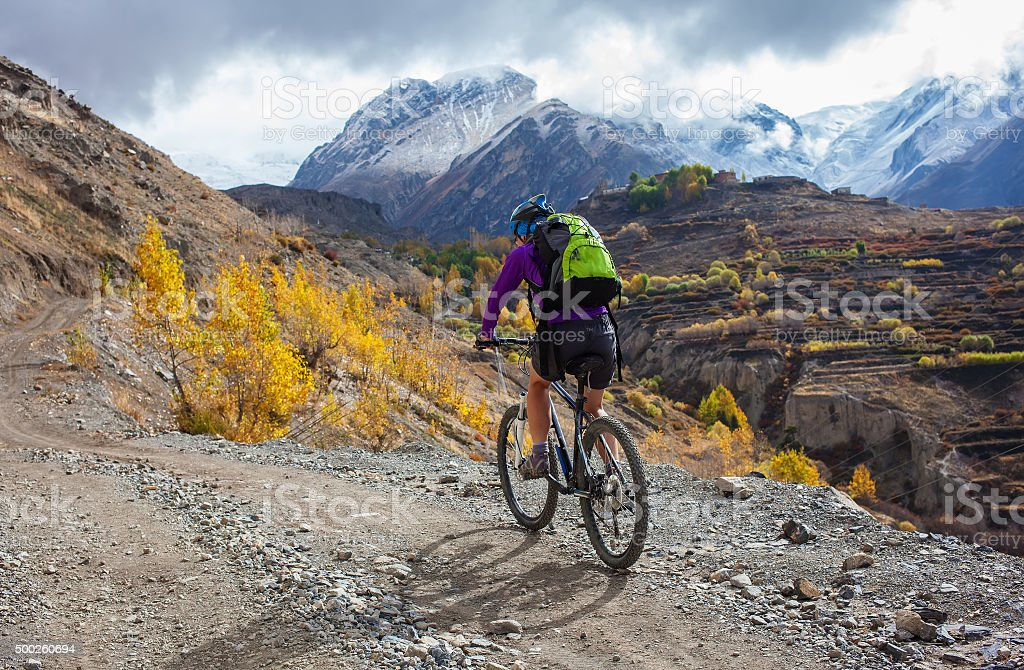 Biker-girl in Himalaya mountains, Anapurna region stock photo
