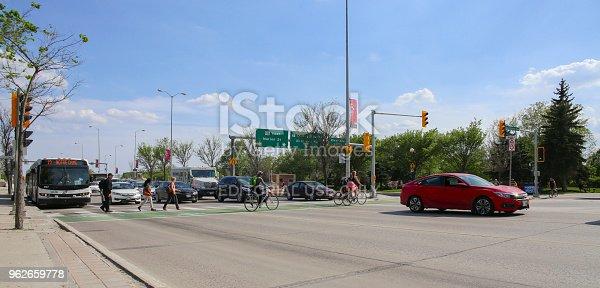 583973114istockphoto Bikers and pedestrians crosswalk in a sunny day 962659778
