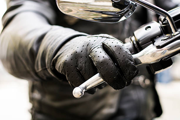 Biker's hand on brake lever handlebar - foto de stock