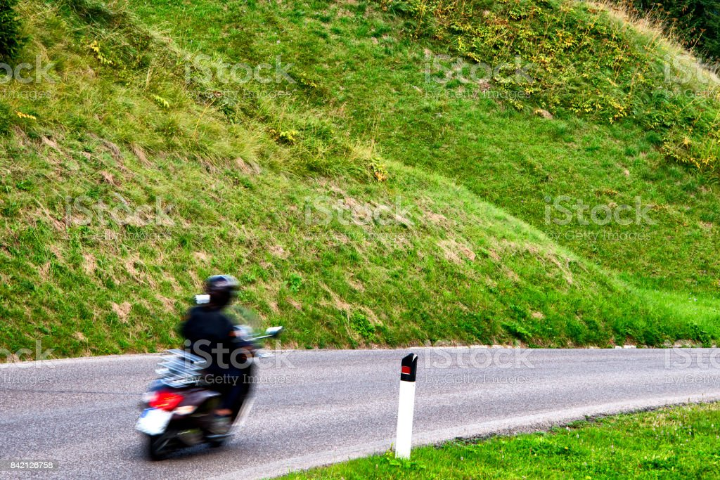 Bikers on Dolomites Alps road stock photo