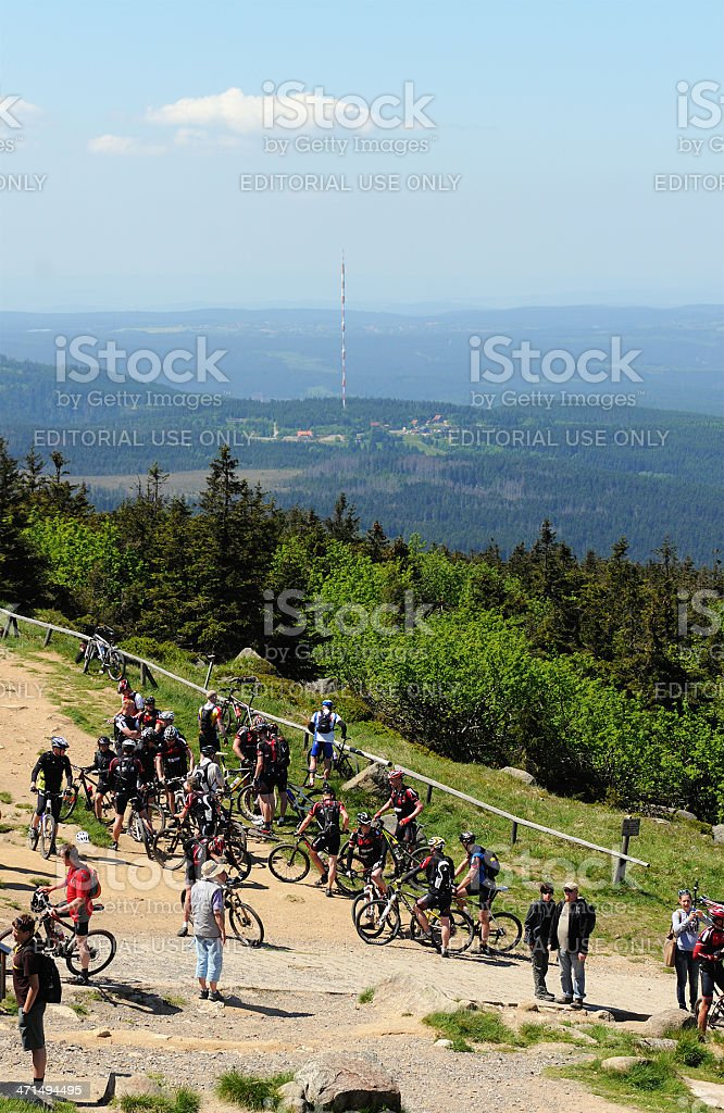 bikers on the way to peak of Brocken Mountain royalty-free stock photo
