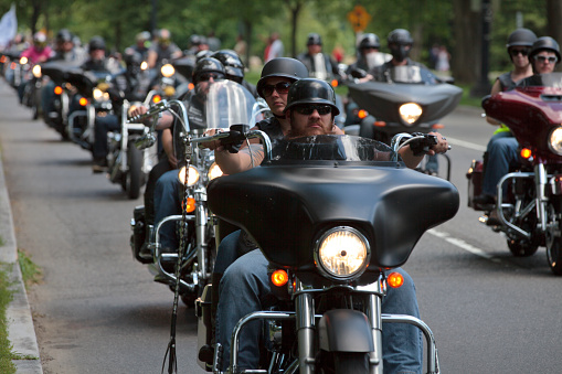 """Washington DC, USA - May 25, 2014: Large group of motorcycles looping around the Mall in Washington DC as part of the annual Rolling Thunder motorcycle """"Ride for Freedom"""" for American POWs and MIA soldiers."""