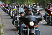 "Washington DC, USA - May 25, 2014: Large group of motorcycles looping around the Mall in Washington DC as part of the annual Rolling Thunder motorcycle ""Ride for Freedom"" for American POWs and MIA soldiers."