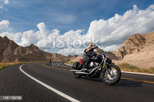Badlands National Park, South Dakota - August 9, 2014: Bikers riding their chopper motorcycles on a road at the Badlands National Park.