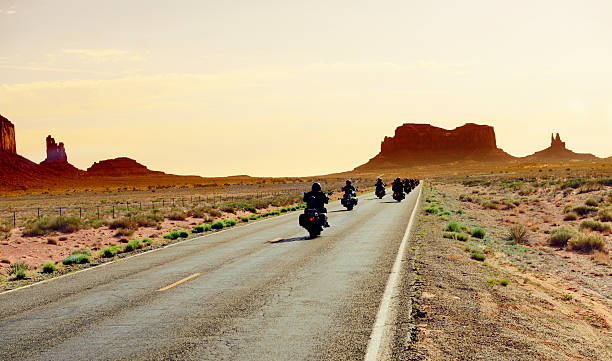 bikers riding to monument valley - biker stock photos and pictures