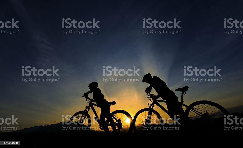 bikers silhouettes royalty-free stock photo