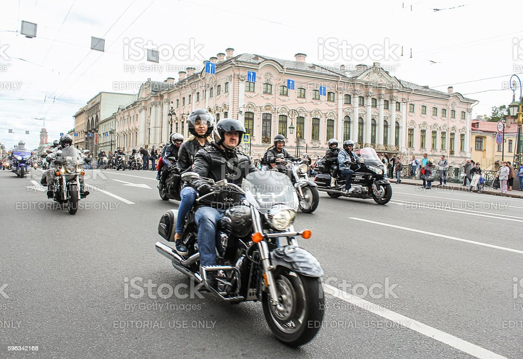 Bikers traveling on the Green Bridge over the Moika River. Lizenzfreies stock-foto