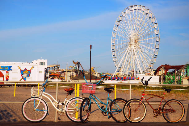 Bikes are chained to a railing along the boardwalk stock photo