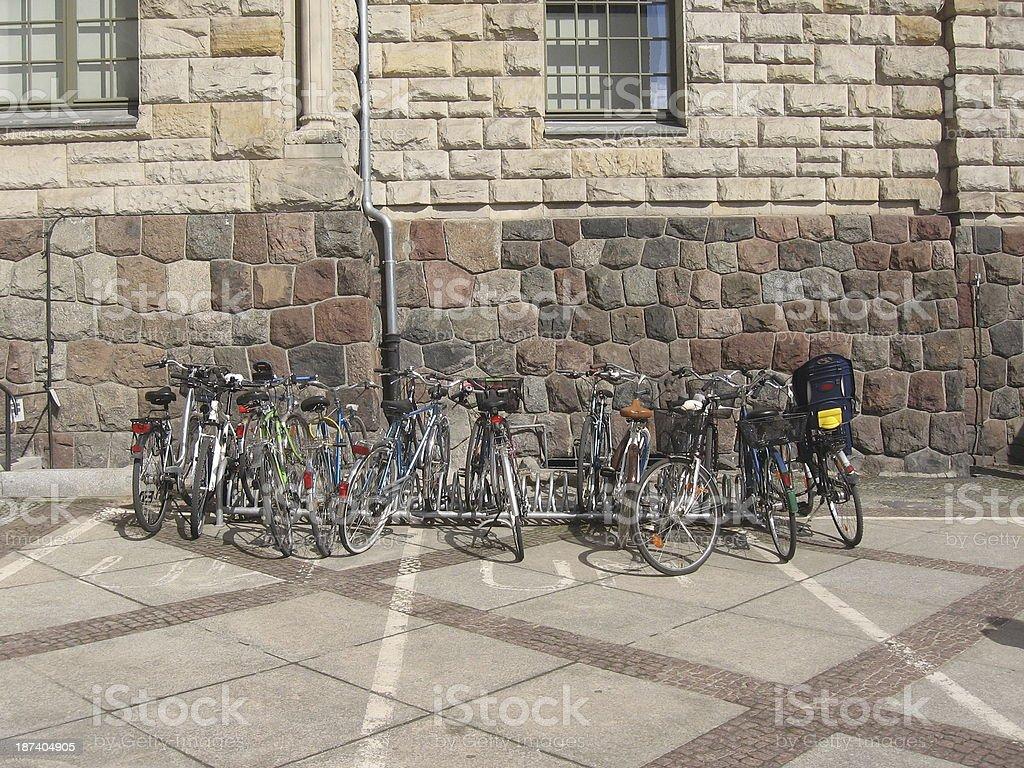 Bikes at a bike rack stock photo