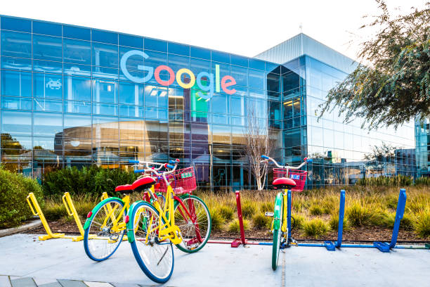 Bikes at Googleplex - Google Headquarters Mountain View, Ca/USA December 29, 2016: Googleplex - Google Headquarters with biked on foreground google stock pictures, royalty-free photos & images