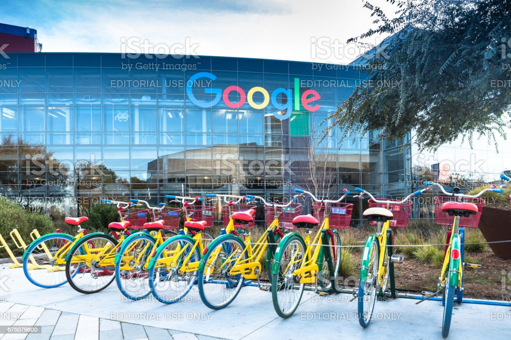 Bikes at Googleplex - Google Headquarters Mountain View, Ca/USA December 29, 2016: Googleplex - Google Headquarters with biked on foreground Android Stock Photo