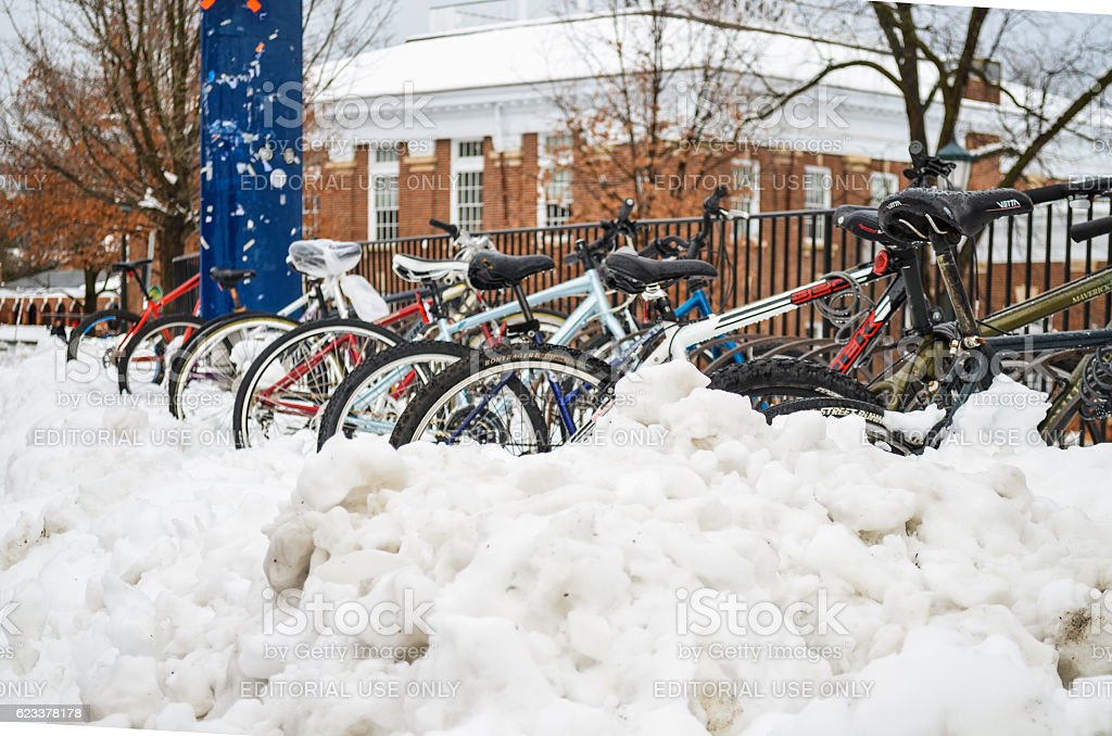 Bikes in rack covered in snow stock photo