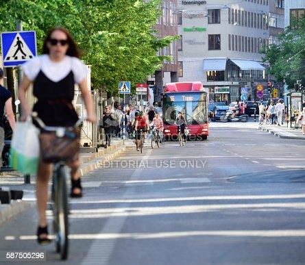 583973114istockphoto Bikes in traffic 587505296