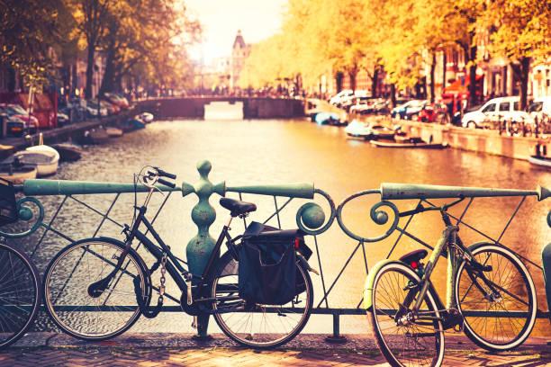 Bikes on the bridge in Amsterdam, Netherlands, Europe. stock photo