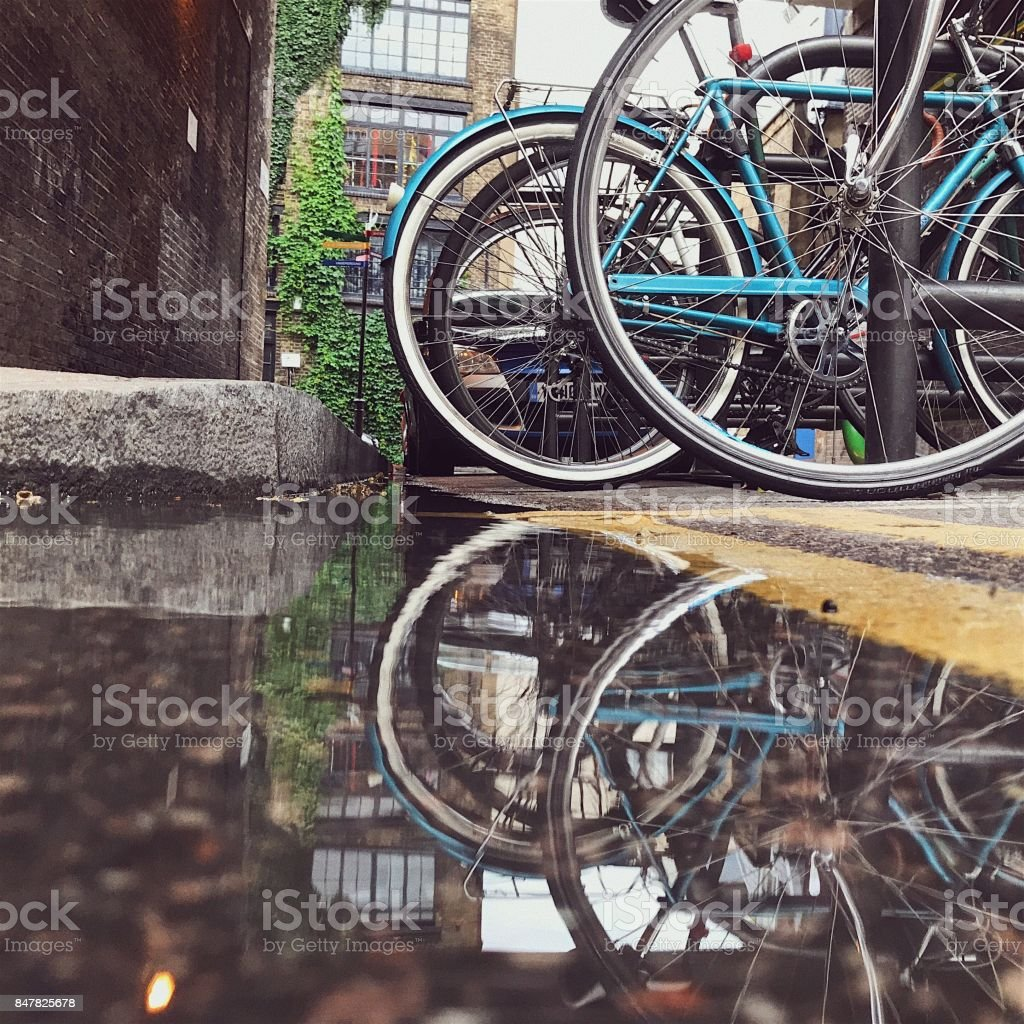 Bikes reflected in a London street puddle stock photo