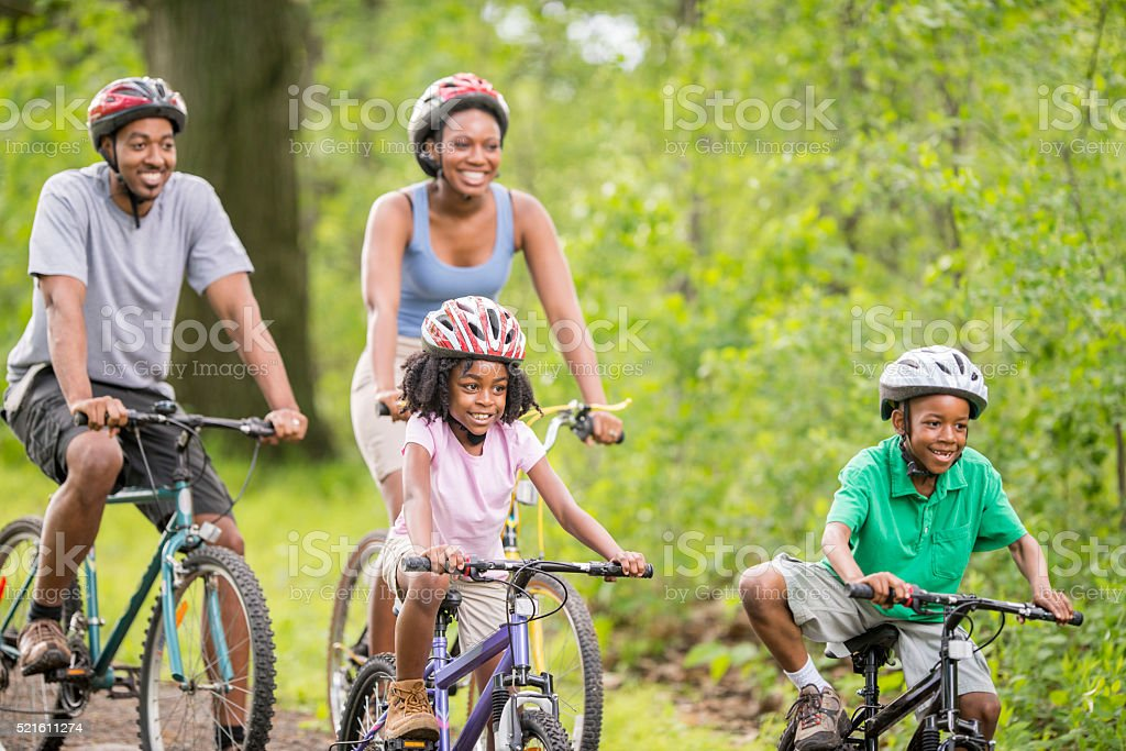 Biking Down a Woodland Path stock photo