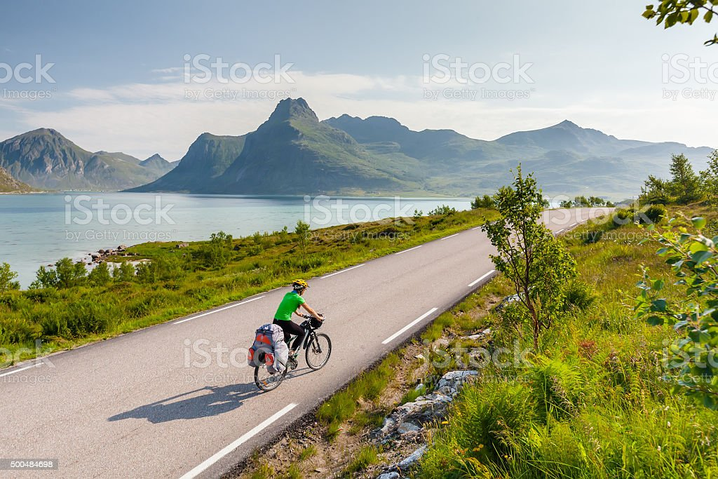 Biking in Norway against picturesque landscape stock photo