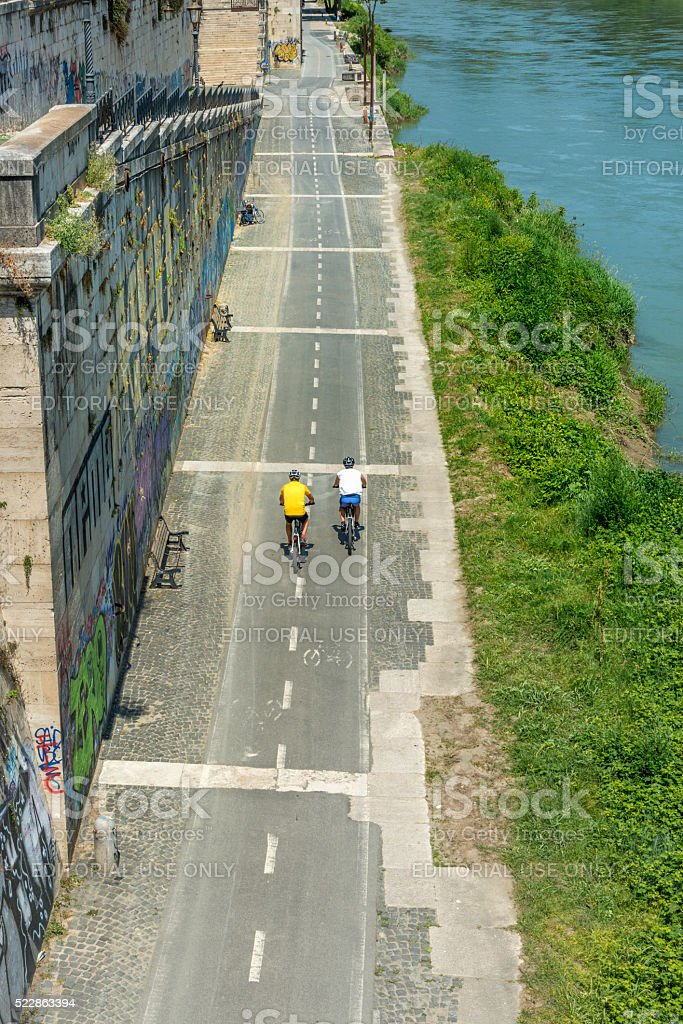 Biking on Tiber riverside, Rome stock photo