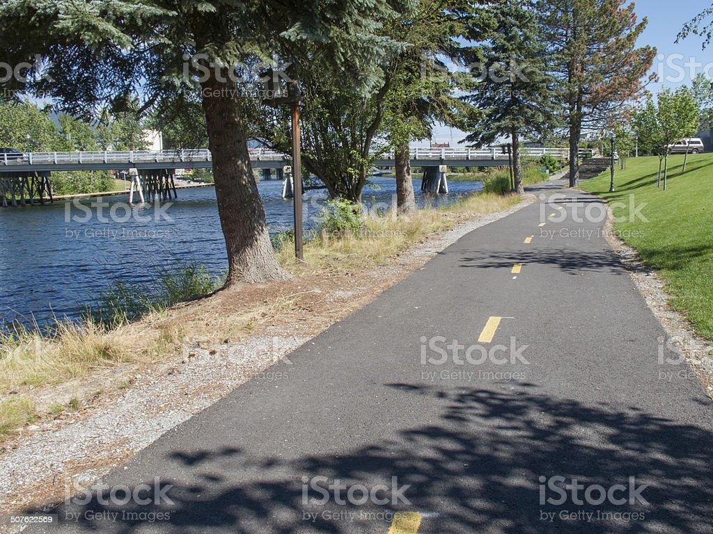 Biking trail next to harbor in Sandpoint Idaho stock photo