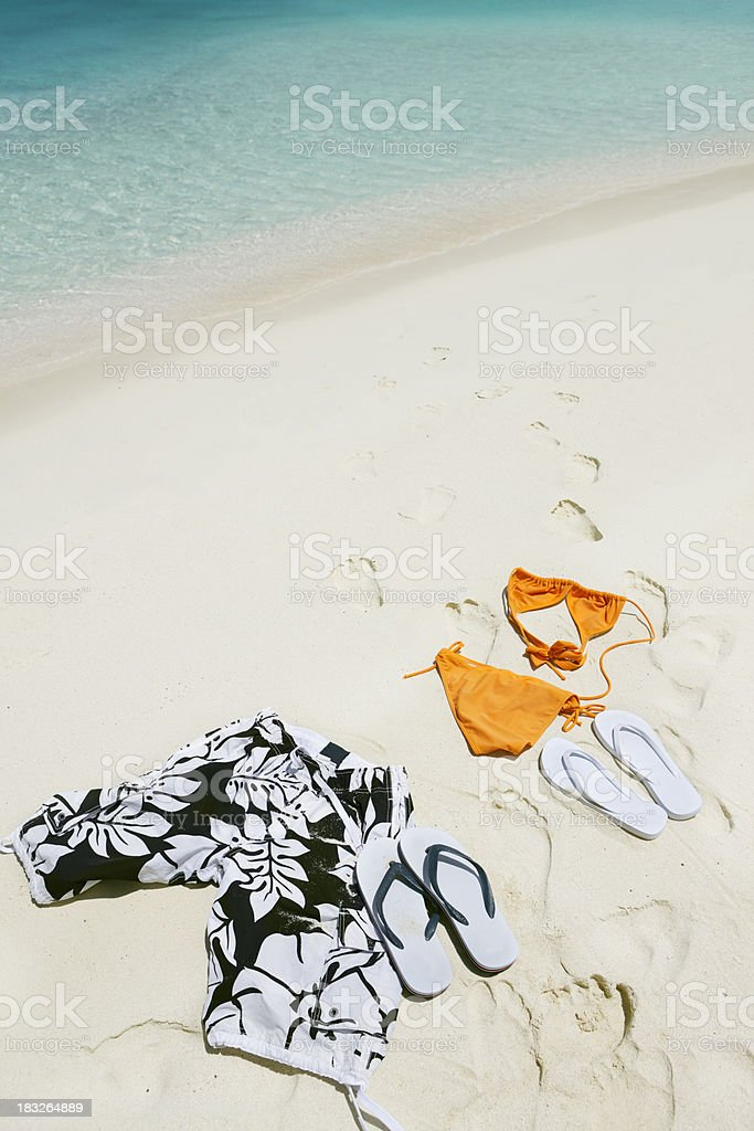 bikini and swimming trunks in sand on a Caribbean beach stock photo
