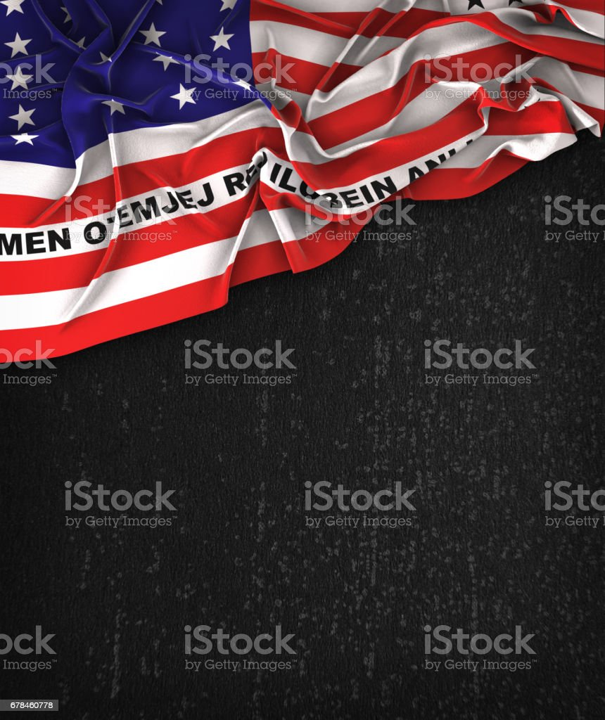 Bikini Atoll Flag Vintage on a Grunge Black Chalkboard With Space For Text royalty-free stock photo