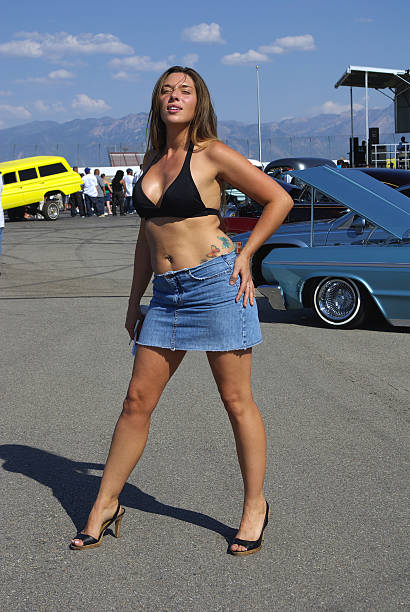 bikini model at lowrider car show - mikefahl stock pictures, royalty-free photos & images