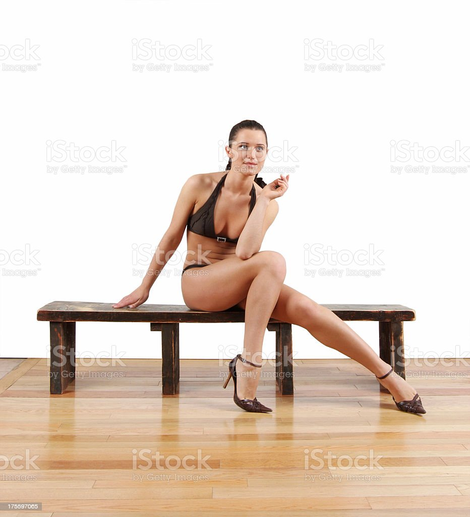 Bikini model on bench royalty-free stock photo