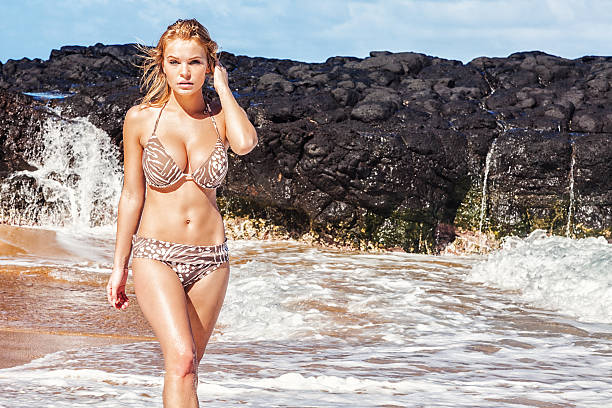 bikini model posing on remote hawaiian beach - curvy voluptuous women stock photos and pictures