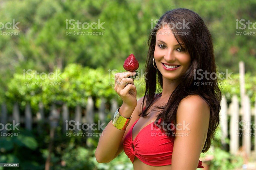 Bikini model with strawberry smiling royalty-free stock photo