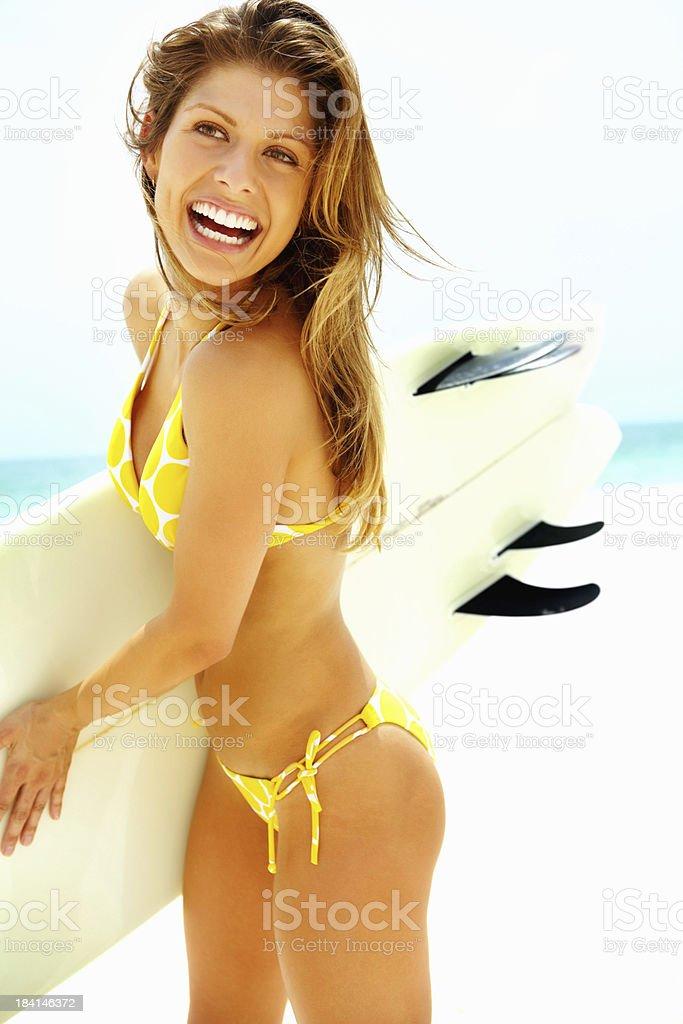 Bikini woman with a surf board royalty-free stock photo