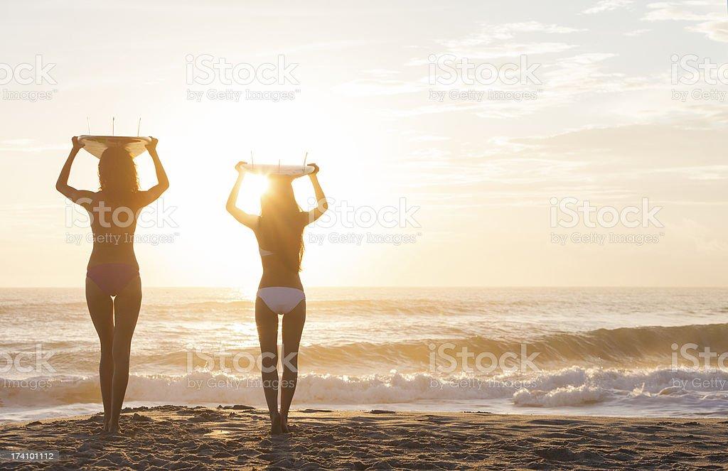 Bikini Women Surfers & Surfboards Sunset Beach stock photo