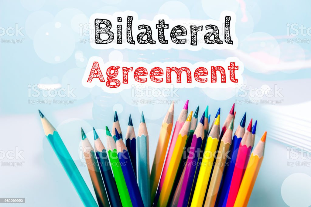 Bilateral Agreement Text Message On Blue Background With Color