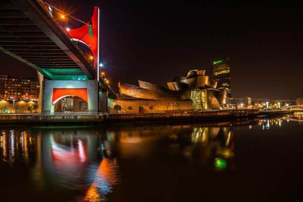 Bilbao night view with three famous landmarks: La Salve Bridge, Guggenheim Museum and Iberdrola Tower, Basque Country, Spain stock photo
