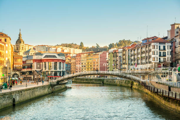 bilbao riverbank on sunny day, spain stock photo